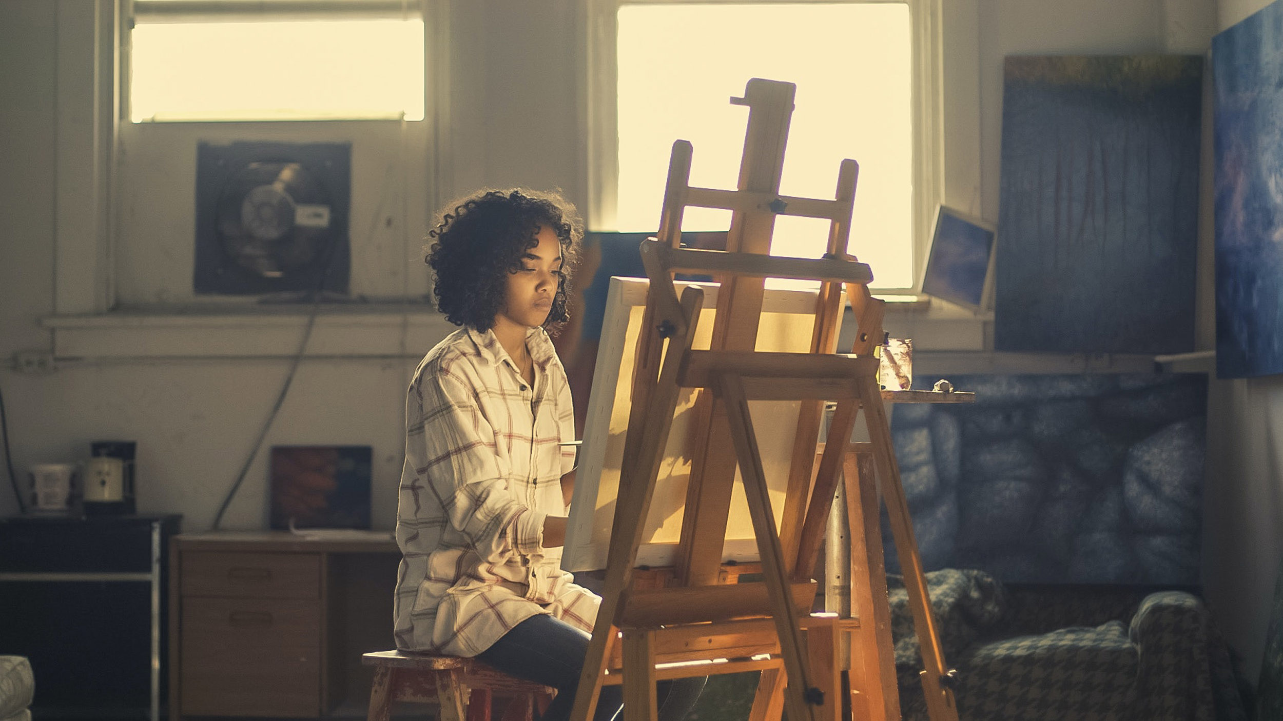 teen at easel