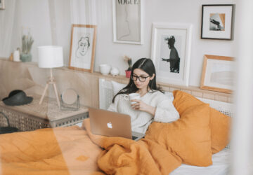woman on computer in bed